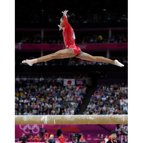 Gymnastics Fab Five Gabby Douglas in Mid-Air on Balance Beam 8x10