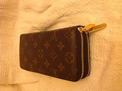 2878930b60ae Louis Vuitton Clutch Strap. LOUIS VUITTON Monogram Eva ...