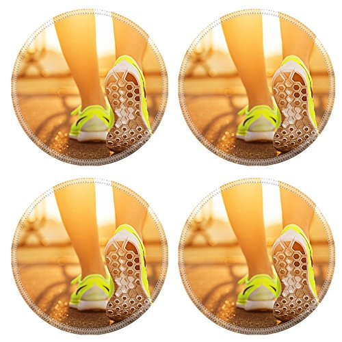 MSD Natural Rubber Round Coasters IMAGE ID 31878071 Runner woman feet running on road closeup on shoe Female fitness model sunrise jog workout Sports healthy lifestyle c