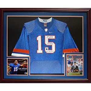 Tim Tebow Autographed Florida Gators (Blue Pro Combat Pride) Deluxe Framed Jersey w ... by PalmBeachAutographs.com