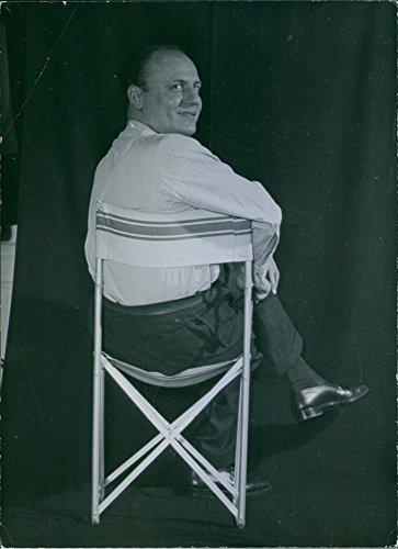 vintage-photo-of-french-fashion-designer-pierre-balmain-sitting-on-a-chair