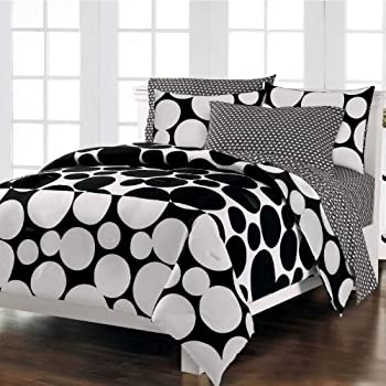 Spot the Dot Mini Twin Bed in a Bag - Black (NEW in Original Packaging)Dots are hot, and this graphic Spot The Dot mini complete bedroom ensemble takes a dramatic modern approach to this trendy motif. The face of the comforter and the standard flange...