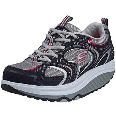 Skechers Women's Shape Ups - Action Packed Fashion Sneaker,Navy/Silver,7.5 M US