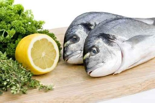 Two Fresh Sea Bream on Wooden Board with Herbs and Lemon - 18