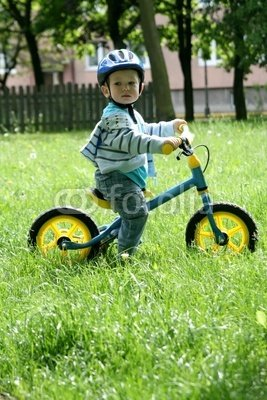 """Wallmonkeys Peel and Stick Wall Decals - Child Learning to Ride on a First Bike without Pedals - 18""""H x 12""""W Removable Graphic"""
