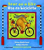 img - for Bear on a Bike/Oso En Bicicleta by Stella Blackstone (2014-08-01) book / textbook / text book