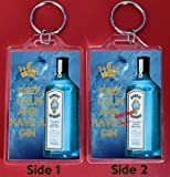 A Large Keyring with KEEP CALM and HAVE A GIN on the Front and KEEP CALM and HAVE Another GIN on the Reverse superimposed on an image of a bottle of Bombay Sapphire Gin. An Original Birthday or Father's Day Gift for a Gin & Tonic Lover.