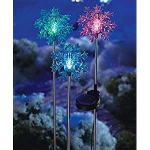 Click to read our review of Christmas Solar Lights: Solar Powered Christmas Snowflakes Yard Light by Winston Brands