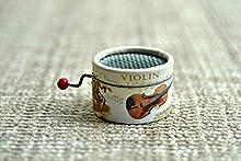 Caja de música manual redonda de violines con melodías de música clásica.