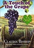 img - for A Touch of the Grape: A Hemlock Falls Mystery (Hemlock Falls Mystery series) book / textbook / text book