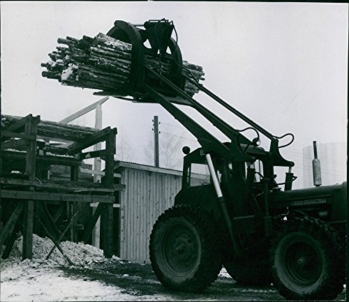 vintage-photo-of-wooden-logs-transported-by-payloader1972