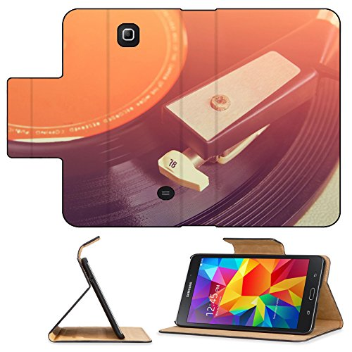 Luxlady Premium Samsung Galaxy Tab 4 7.0 Inch Flip Pu Leather Wallet Case IMAGE ID: 34194137 close up image of old record player image is retro filtered selective focus (Old Fashion Turntable compare prices)