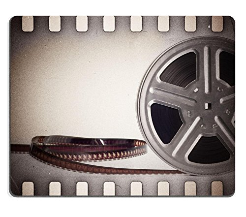 Luxlady Mousepad Old motion picture film reel with film strip Vintage background IMAGE 20239841 (Vintage Film Reel compare prices)