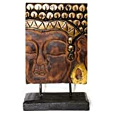 A BEAUTIFUL HAND CARVED BUDDHA PLAQUE ON A STAND