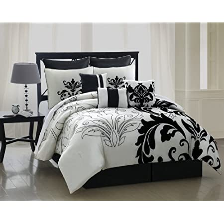 Give your bedroom a fresh and modern look with this splendid bedding. The comforter set features large scale scroll leaf flocking on white ground. 3 decorative pillows and 2 euro shams further complement the look.FeaturesColor: Black/WhiteSize: Queen...