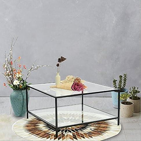 Fornisce 1elegante tavolino con top in vetro con telaio nero