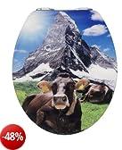 Wenko 21366100 - Tavoletta per WC in acrilico lucido, soggetto: mucca e montagna, chiusura rallentata automatica, coperchio 38 x 45 cm, anello esterno 37 x 43,5 cm, apertura 37 x 43,5 cm, distanza montaggio 11- 20,5 cm