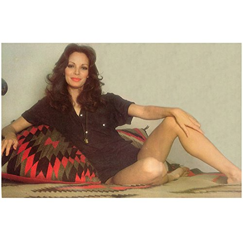 jaclyn-smith-in-black-top-seated-leaning-against-pillow-8-x-10-inch-photo