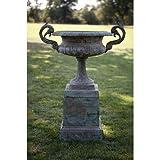 Cast iron handled urn on a plinth