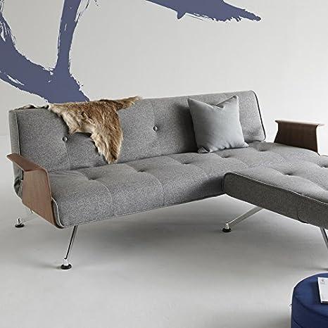 Innovación en el sofá cama con diseño de patas de cromo y reposabrazos clubber