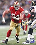Justin Smith Autographed San Francisco 49ers 8×10 Photo (red jersey) w/JSA