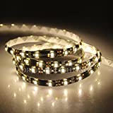 XKTTSUEERCRR 16.4ft 5M - Black PCB 3528 SMD 300LED Roll - Warm White - Waterproof(IP65) Flexible Strip Light - DC 12V For Car Truck Mall Booth Stage House Decoration + DC Connector + 12V 2A Power Supply