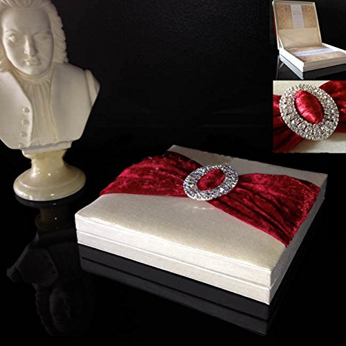 Cream color silk covered wedding invitation box with large oval buckle