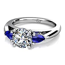 buy Platinum Luxurious And Stylish Traditional 3 Stone Ring Featuring A Round Center Stone Complimented By Two Sapphire Pear Shaped Side Stones And Finished With A Diamond Shank. 1/4 Ctw Near-Colorless Color Si1-Si2 Clarity