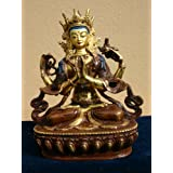 Green Tara statue with a stunning hand painted face, which is partially gilded in gold.by Tibetan Dawn
