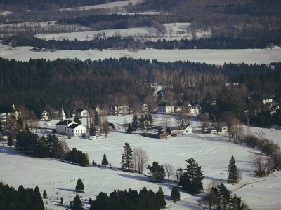 Aerial of a Steepled Church and White Clapboard Homes Near Craftsbury
