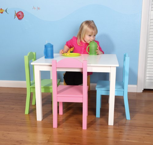 white painted wood table is accented with 4 pastel child size chairs