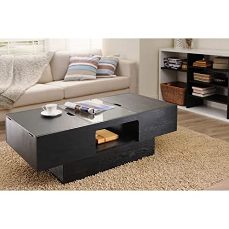 Stevie Black Finish Hidden Storage Coffee Table. This piece is composed with sturdy wood materials, convenient storage space and nicely coated in a sleek black finish. Guaranteed