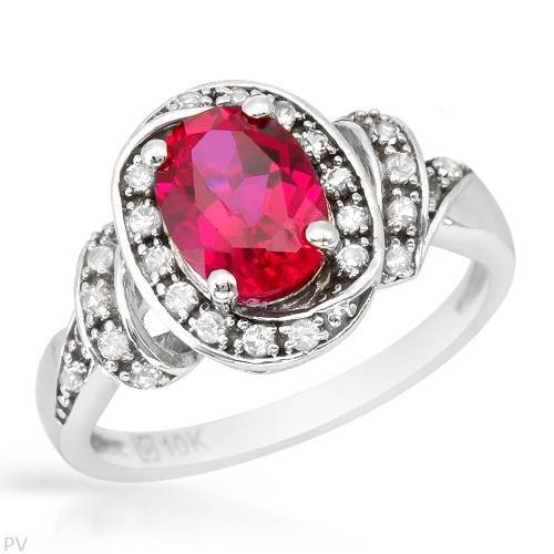 White Gold 1.65 CTW Ruby and 0.3 CTW Sapphire Ladies Ring. Ring Size 6.5. Total Item weight 3.7 g.