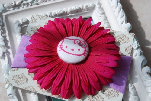 Adorable Large Fuchsia Daisy with Custom Made Hello Kitty and Swarovski Crystals Button on Super Soft, Stretchy Lavender Headband. Fits Baby up to Young Girl