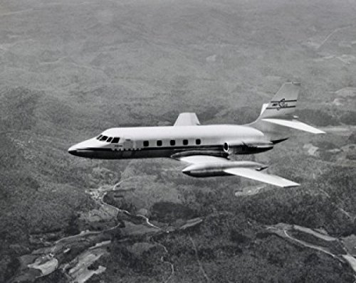 high-angle-view-of-an-aircraft-in-flight-lockheed-jetstar-poster-drucken-6096-x-9144-cm