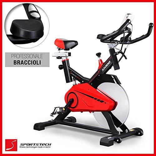 Sportstech SX100 cyclette professionale con volano di 14KG, bracciolo imbottito, sedile comfort con molla di sospensione - SpeedBike con sistema a basso rumore - bicicletta con ergometro fino a 120 kg