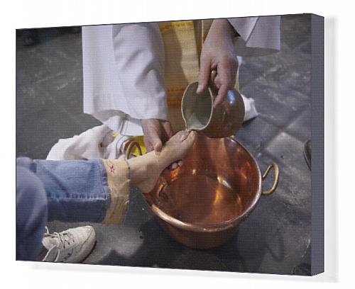 Feet washing ritual during Maundy Thursday celebration in a Catholic church.