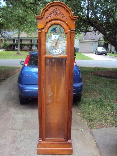 Howard Miller Holland Grandfather Clock in Yorkshire Oak Finish 610-569