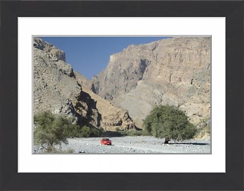 framed-print-of-gravel-road-along-the-floor-of-deep-wadi-below-limestone-cliffs-wadi-bani-habib