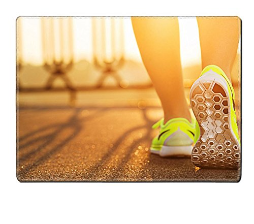 MSD Natural Rubber Placemat Kitchen Table 15.8 x 12 x 0.2 inches IMAGE ID 31878071 Runner woman feet running on road closeup on shoe Female fitness model sunrise jog workout Sports healthy lifestyle c