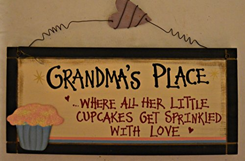 "Rustic Country Wood Plaque Sign Decoration with a Metal Wire for Hanging 12 x 5 1/2 x 3/4 Inches. Wooden Sign Saying ""Grandma's Place... Where All Her Little Cupcakes Get Sprinkled With Love"" with Decoration Pink Sparkle Cupcake in Blue Wrapper and Black Border"