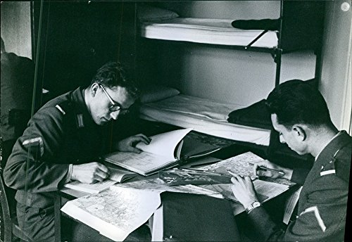 vintage-photo-of-soldiers-plotting-the-maps-and-marking-some-books