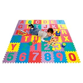 boy playing on playmat