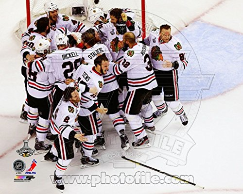 The Chicago Blackhawks celebrate winning Game 6 of the 2013 Stanley Cup Finals Photo 10 x 8in