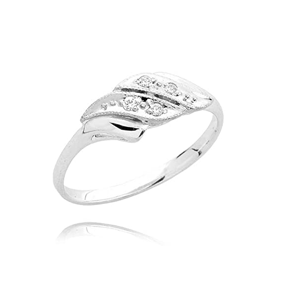 Four zirconia on white gold pave ring