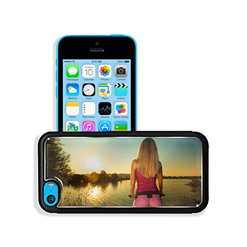 Luxlady Premium Apple iPhone 5C Aluminum Backplate Bumper Snap Case IMAGE ID: 31398848 Close up of rear view of a pretty woman on bicycle relaxing at Sunset