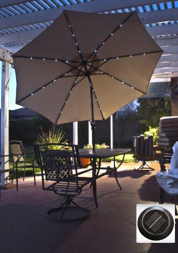 solar powered 9 39 tan patio umbrella with tilt 32 super. Black Bedroom Furniture Sets. Home Design Ideas