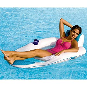 Woman relaxing on floating recliner