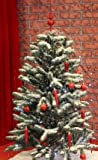 Snowing Christmas Tree Green Base 4 Feet 5 Inches Tall