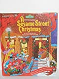 img - for A Sesame Street Christmas: Featuring Jim Henson's Sesame Street Muppets book / textbook / text book